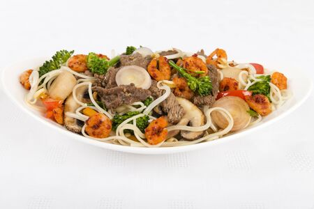 Chow Mein - Chinese Stir-fried noodles with beef, shrimp on a white background  photo