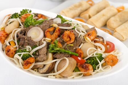 Chow Mein - Chinese Stir-fried noodles with beef, shrimp and vegetables on a white background Stock Photo - 17050379
