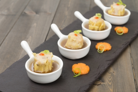 Siu Mai - Chinese steamed pork dumplings in hot and sour soup Stock Photo - 17050375