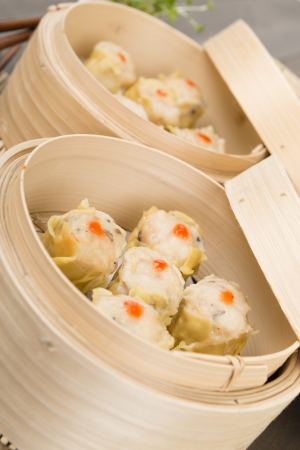 Siu Mai - Chinese steamed pork dumplings in bamboo steamers  Dim Sum Stock Photo - 17050372