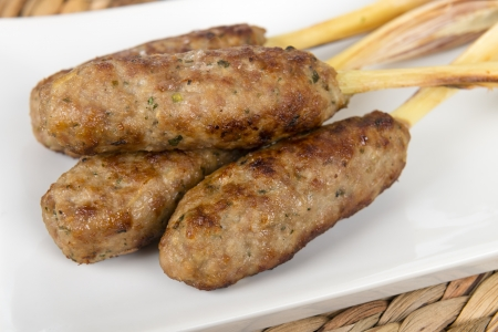 nem: Nem Noung Xa - Vietnamese minced pork sausages on lemongrass skewers Stock Photo