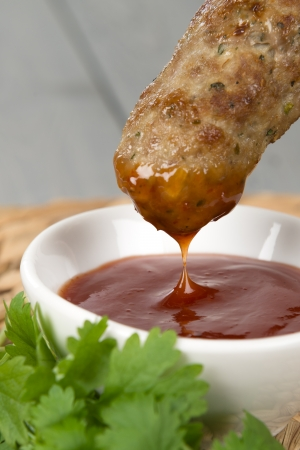 Nem Noung Xa - Vietnamese minced pork sausages on lemongrass skewers served with chili sauce  Stock Photo - 17050370
