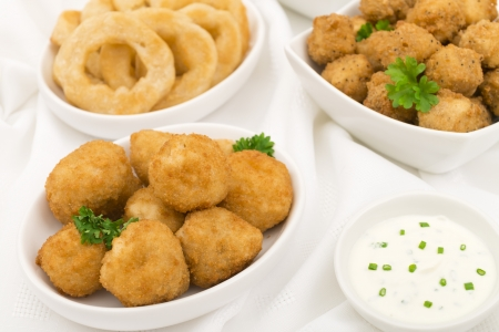 bowls of popcorn: Party Food - Breaded mushrooms, popcorn chicken, onion rings served with sour cream and chives dip