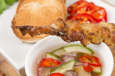 malaysian food: Moo Satay - Thai pork satay served with peanut sauce, cucumber relish and toast