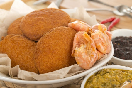 Acaraje - Traditional Brazilian fritters made with black-eyed peas served with caruru, sauteed shrimp and chilli sauce  Typical food from Bahia Stock Photo - 17050205