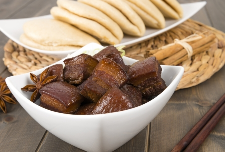 Hong Shao Rou  Red Cooked Pork  - Chinese pork belly caramelized and braised in soy sauce with star anise, cinnamon and chilies, served with steamed buns  he ye bao Stock Photo - 18036229