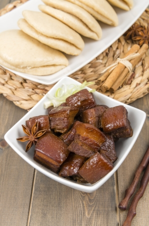 Hong Shao Rou  Red Cooked Pork  - Chinese pork belly caramelized and braised in soy sauce with star anise, cinnamon and chilies, served with steamed buns  he ye bao Stock Photo - 18036260