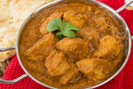 Goan Pork Vindaloo - Indian pork curry with naan bread  Traditional cuisine from Goa  photo