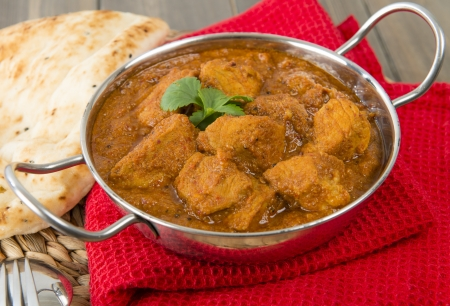Madras: Goan Pork Vindaloo - Indian pork curry with naan bread  Traditional cuisine from Goa  Stock Photo