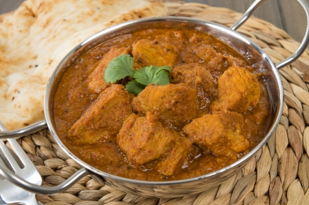 Goan Pork Vindaloo - Indian pork curry with naan bread  Traditional cuisine from Goa Stock Photo - 18036270
