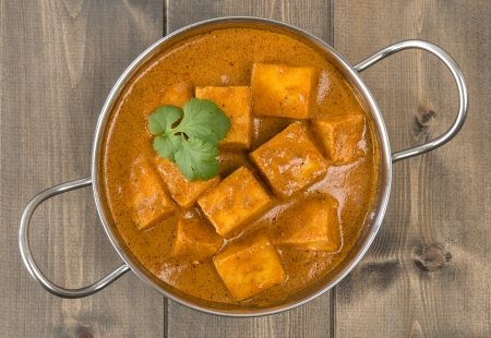 gravy: Paneer Makhani or Shahi Paneer  Paneer Butter Masala  - Indian curd cheese curry in a balti dish and garnished with coriander leaves