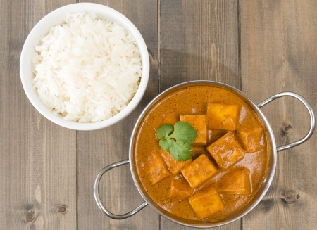 india food: Paneer Makhani or Shahi Paneer  Paneer Butter Masala  - Indian curd cheese curry in a balti dish, served with rice and garnished with coriander leaves  Stock Photo