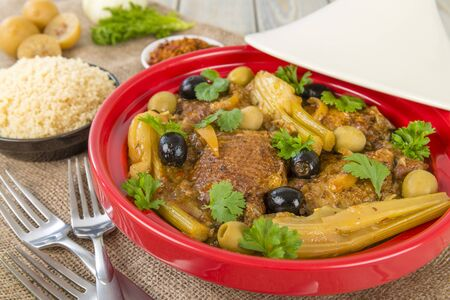 Chicken Tagine - Moroccan chicken tagine with olives, preserved lemon and fennel, served with couscous  Stock Photo - 18036288
