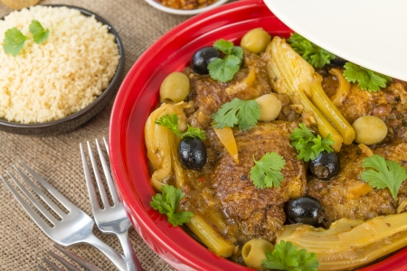 Chicken Tagine - Moroccan chicken tagine with olives, preserved lemon and fennel, served with couscous Stock Photo - 18036284