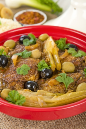 Chicken Tagine - Moroccan chicken tagine with olives, preserved lemon and fennel, served with couscous  Stock Photo - 18036287