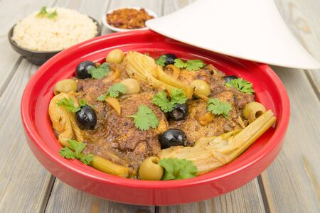 Chicken Tagine - Moroccan chicken tagine with olives, preserved lemon and fennel, served with couscous Stock Photo - 18036264