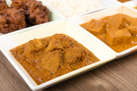Thali - Indian meal set with vegetarian and meat curries - pork vindaloo, keema madras, tarka dal and paneer makhani Stock Photo - 18036269
