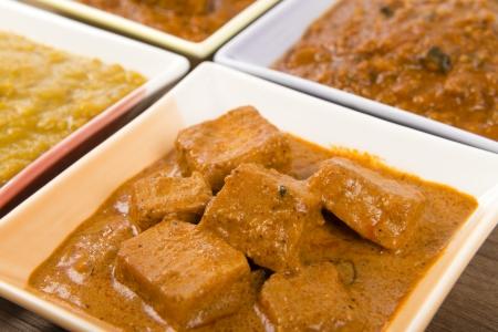 indian meal: Thali - Indian meal set with vegetarian and meat curries - pork vindaloo, keema madras, tarka dal and paneer makhani