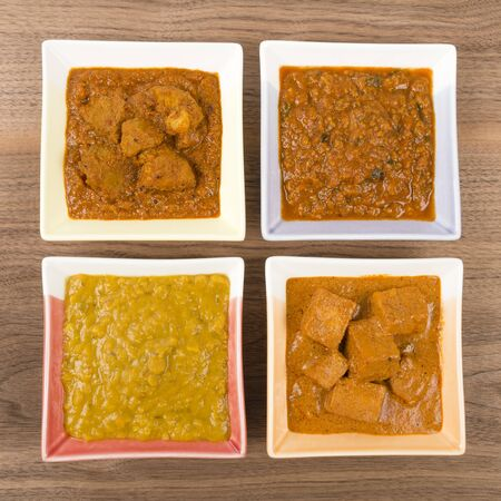 Thali - Indian meal set with vegetarian and meat curries - pork vindaloo, keema madras, tarka dal and paneer makhani  photo