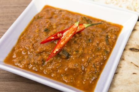 Keema Madras - Minced lamb curry garnished with chilies and served with rice and chapatis