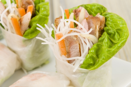 Goi Cuon - Vietnamese fresh summer rolls filled with prawns, pork, herbs, rice vermicelli and vegetables  Served with hoisin and peanut sauce dip and nuoc mam cham  Wooden background Stock Photo - 18036220