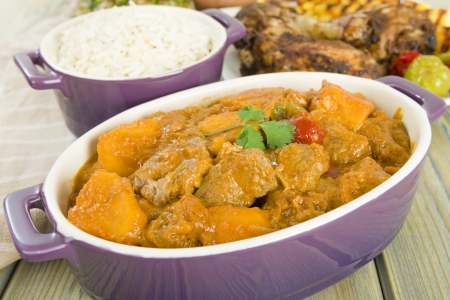 Lamb and sweet potato peanut stew served with white rice  Caribbean and West African dish Stock Photo - 21928143