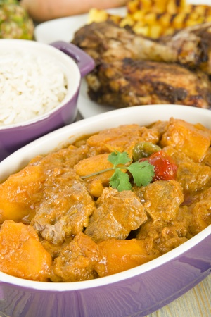 jamaican: Lamb and sweet potato peanut stew served with white rice  Caribbean and West African dish   Stock Photo