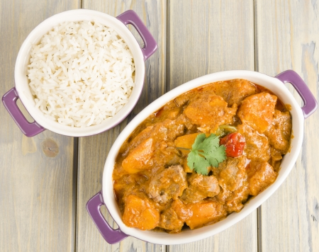 Lamb and sweet potato peanut stew served with white rice  Caribbean and West African dish   Stock Photo