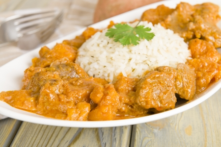 peanut sauce: Lamb and sweet potato peanut stew served with white rice  Caribbean and West African dish   Stock Photo