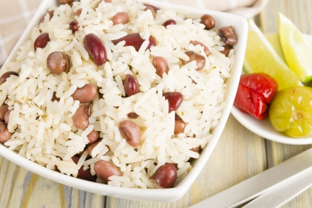 Rice and Peas - Caribbean coconut rice with red kidney beans, cowpeas and pigeon peas  Scotch bonnet chilies and lime on side Reklamní fotografie - 21928179
