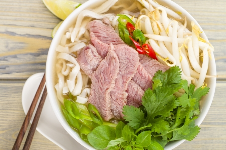 Pho Bo - Vietnamese fresh rice noodle soup with beef, herbs and chili  Vietnam s national dish   photo