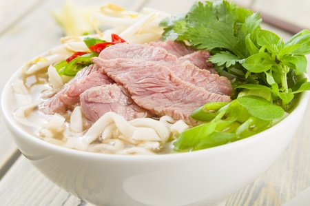 Pho Bo - Vietnamese fresh rice noodle soup with beef, herbs and chili  Vietnam s national dish