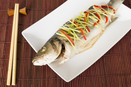 Steamed Fish - Chinese style steamed sea bass garnished with ginger, chili and spring onions   Stock Photo - 21928319