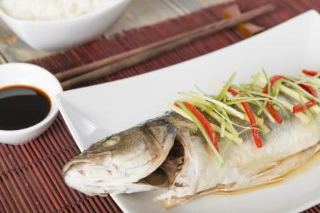 Steamed Fish - Chinese style steamed sea bass garnished with ginger, chili and spring onions   Stock Photo - 21928327