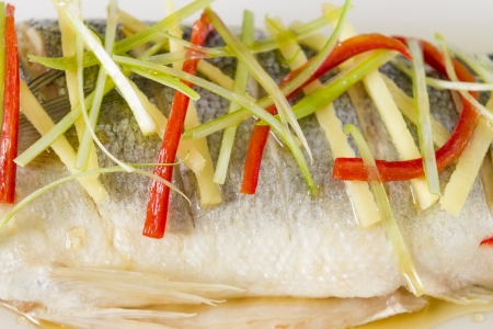 Steamed Fish - Chinese style steamed sea bass garnished with ginger, chili and spring onions   Stock Photo - 21928329