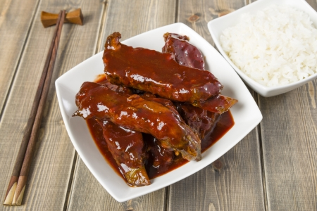 Char Siu - Chinese sticky pork spare ribs roasted with a sweet and savoury sauce served with boiled rice   Stock Photo - 21928331