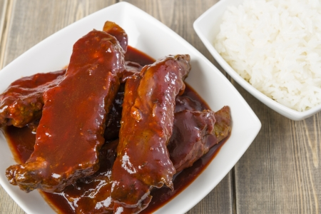 Char Siu - Chinese sticky pork spare ribs roasted with a sweet and savoury sauce served with boiled rice   Stock Photo - 21928332