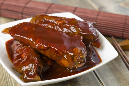 Char Siu - Chinese sticky pork spare ribs roasted with a sweet and savoury sauce   Stock Photo - 21928335