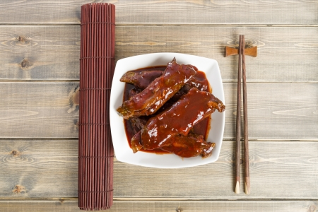 Char Siu - Chinese sticky pork spare ribs roasted with a sweet and savoury sauce  Overhead shot   photo