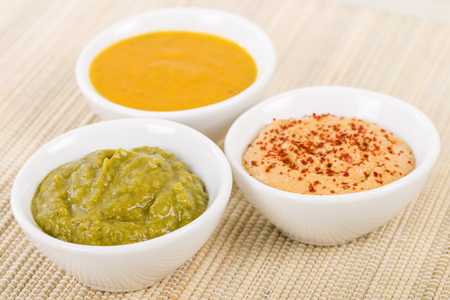 middle eastern food: Dipping Sauces - Amarillo Chilli Sauce, Chimichurri and Roasted Pepper.