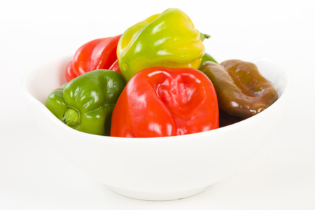 barbadian: Scotch Bonnet - Hot chilli pepper in a white bowl. Stock Photo