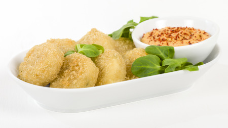 traditional food: Deep Fried Cheese - Breaded and deep fried cheese served with dipping sauce. Stock Photo