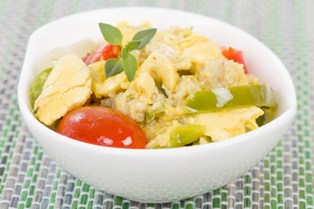 cooked pepper ball: Ackee  Saltfish - Traditional Jamaican dish made of salt cod and ackee fruit.