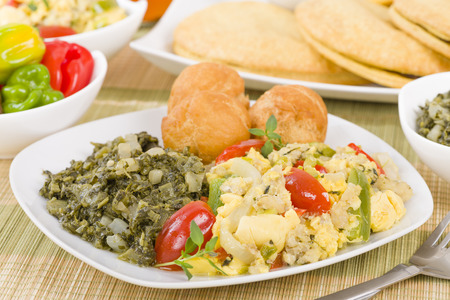 jamaican food: Ackee  Saltfish - Traditional Jamaican dish made of salt cod and ackee fruit. Served with callaloo and johnny cakes.