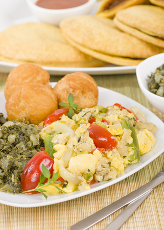 Ackee  Saltfish - Traditional Jamaican dish made of salt cod and ackee fruit. Served with callaloo and johnny cakes. Stock Photo - 49053740