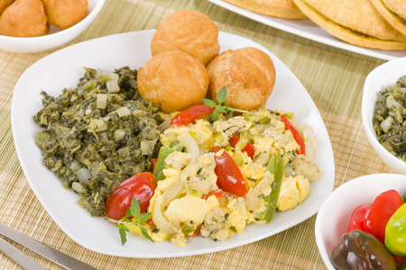Ackee  Saltfish - Traditional Jamaican dish made of salt cod and ackee fruit. Served with callaloo and johnny cakes.