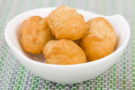 jamaican food: Johnny Cakes - Jamaican fried dumplings in a white bowl.