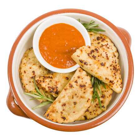 cazuela: Pierogi - Baked dumplings filled with meat and served with a spicy sour cream based dip. Stock Photo