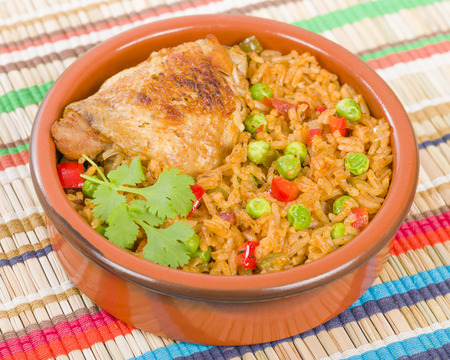 bowl with rice: Arroz Con Pollo - Chicken and rice cooked with sofrito and beer.