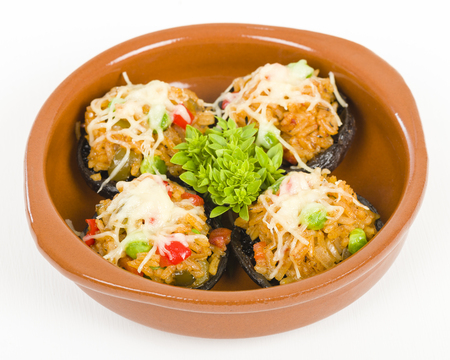 cazuela: Stuffed Mushrooms - Mushrooms topped with cooked spicy rice and cheese.
